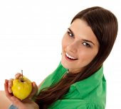 beautiful teenager girl holding apple isolated on white background
