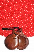 closeup of castanets and flamenco dress typical of Spain
