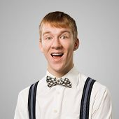 Happy Hipster With Mouth Opened. Emotional Redhead Boy Has Surprised Facial Expression. Portrait Of  poster