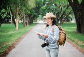 Asian Woman Backpack Traveler Use Map When Traveling At Rain Forest.holiday Vacation Concept.journey poster