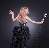 Female Singer With Microphone Performing Jazz Composition. poster