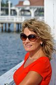 Attractive Age Woman In Sunglasses Wearing Red Top