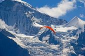 Paragliding in swiss alps Jungfrau region, Switzerland