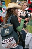 Woman Filming Iraq War Protest