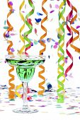 Martini Glass With Alcohol While Streamers And Confetti In Background