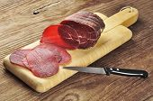 Sliced Bresaola On A Cutting Board