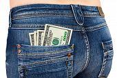 Dólares no bolso traseiro de Jeans