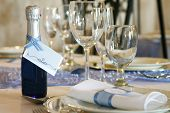picture of dinner invitation  - bottled invitation table setting  - JPG