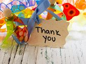 thank you note with colorful ribbons