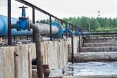 stock photo of groundwater  - Oxygen supplying into the sewage water in tanks - JPG