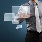 Modern businessman press a digital button on a touch screen