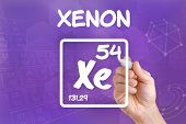 Hand drawing the symbol for the chemical element xenon