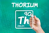 Hand drawing the symbol for the chemical element thorium