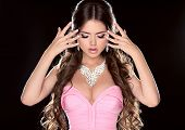 Beauty Woman. Fashion Model Girl With Long Brown Hair Showing Jewelry In Pink Dress  Isolated On Bla
