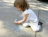 Child Drawing On Sidewalk