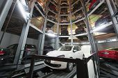 MOSCOW - JAN 11: The Volkswagen Golf on parking lot with a multi-story automated car parking system