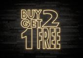 Buy Two Get One Free Sign On Classy Stone Wall