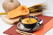 stock photo of pine nut  - Hot delicious pumpkin soup in a bowl - JPG