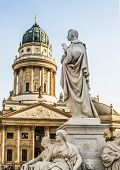 Beautiful squares in Berlin, the Gendarmenmarkt, marble statue of German poet Friedrich Schiller