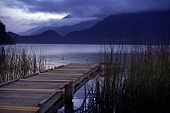 stock photo of dock a lake  - Wood Dock and the Boat - JPG