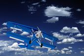 stock photo of biplane  - Blue Biplane on the Sky - JPG