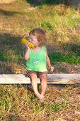 Child To Eat Corncob On The Bench