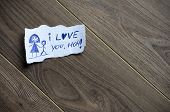 picture of i love you mom  - I love you Mom written on piece of paper on a wood background - JPG