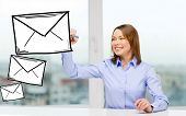 office, business, technology concept - businesswoman drawing envelope on virtual screen