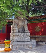 stock photo of lamas  - Stone Qilin statue at the famous Lama temple china - JPG