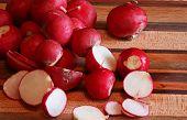 Red Globe Radishes On A Cutting Board