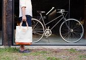 Man With Canvas Bag And Vintage Bicycle