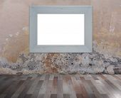 White frame on grunge wall