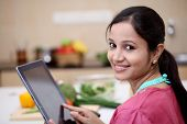Young Indian Woman Using A Tablet