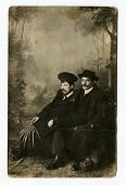 MOSCOW, RUSSIA - CIRCA 1900s: An antique photo shows studio portrait of a two men in overcoats and h