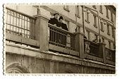 MOSCOW, USSR - CIRCA 1950s:  An antique photo shows portrait of two men standing on the balcony of a