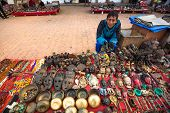 KATHMANDU, NEPAL - NOV 29, 2013: Unidentified sellers souvenirs at Durbar Square. Preference for con