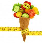 Fresh mixed vegetables on ice cream cone with a tape measure