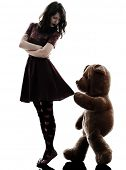 image of vicious  - one caucasian strange young woman and vicious teddy bear in silhouette white background - JPG