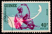 GUINEA CIRCA 1962: stamp printed by Guinea, shows Musical Instrument, Bolon, circa 1962