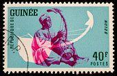 GUINEA CIRCA 1962: stamp printed by Guinea, shows Musical Instrument, Bolon, circa 1962