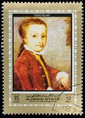 AJMAN - CIRCA 1972: A stamp printed in Ajman shows portrait of the great musician and composer Wolfg