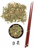Ginkgo leaf chinese herbal medicine with chopsticks and mandarin script title translation. Yin xing.