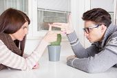 Couple In Confrontation Pointing At Each Other With Challenge Attitude