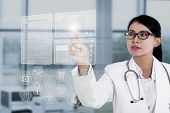 Female Doctor Touching Medical Interface