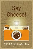 Retro photographic poster with the slogan Say Cheese!, on crumpled brown paper background. EPS10 vector format