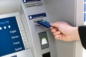 Businessman Puts Credit Card Into Atm