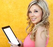 Beautiful Girl Holding A Tablet