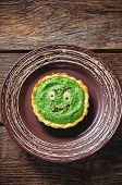 Tartlet With Spinach Cream For Halloween In The Form Of A Monster