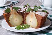 Chocolate Cake With Whole Pears And Mint Closeup Horizontal