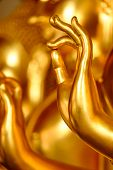 image of vihara  - A hand of a golden Buddha statue in Thai Buddhist temple - JPG